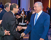 Prime Minister Benjamin Netanyahu of Israel, right, shakes hands with United States Ambassador to Israel Dan Shapiro, left, as he arrives to address the 2015 Jewish Federations of North America General Assembly at the Washington Hilton Hotel in Washington, DC on Tuesday, November 10, 2015.<br /> Credit: Ron Sachs / CNP