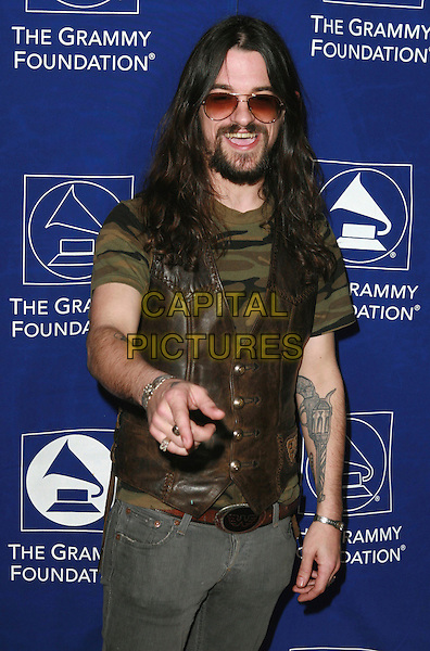 "SHOOTER JENNINGS.The Grammy Foundation presents the 9th Annual Music Preservation Project, ""The Soul Of Country"" celebrates the Magic and History of Country Music at the Wilshire Ebell Theater, Los Angeles, California, USA..February 8th, 2007.half length hand finger pointing beard facial hair brown vest waistcoat sunglasses shades.CAP/ADM/CH.©Charles Harris/AdMedia/Capital Pictures"