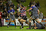 Jared Adams bursts through Codie Taylors tackle. The game of Three Halves, a pre-season warm-up game between the Counties Manukau Steelers, Northland and the All Blacks, played at ECOLight Stadium, Pukekohe, on Friday August 12th 2016. Photo by Richard Spranger.