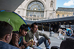 Hundreds of refugees from mostly Syria and Afghanistan gather at the Budapest Keleti railway station waiting for trains to leave for destinations such as Austria, Germany and Sweden, in Budapest, Hungary, on Tuesday, Sept. 8, 2015. Hungary's Prime Minister Viktor Orban created an anti-refugee campaign to generate hate against those fleeing war in their home countries. The country is currently 50% xenophobic and the government has become increasingly authoritarian.
