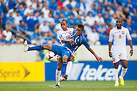 El Salvador midfielder Darwin Ceren (7) battles for the ball with Trinidad and Tobago midfielder Denzil Theobald (18) during a CONCACAF Gold Cup group B match at Red Bull Arena in Harrison, NJ, on July 8, 2013.