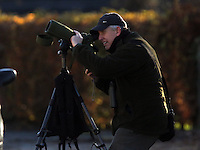 COPY BY TOM BEDFORD<br /> Pictured: One of the birdwatchers observing the masked wagtail seen on house roofs in the village of Camrose, west Wales, UK. Wednesday 30 November 2016<br /> Re: Birdwatchers from all over Britain have turned up in a tiny Welsh village to see the first recorded visit of a masked wagtail.<br /> The species is normally found in Kazakhstan, Iran and Afghanistan but may have been brought here by the icy temperatures.<br /> It was spotted on the roof of a semi-detached house in Camrose, Pembrokeshire, yesterday(tues) but local birdwatchers were unable to identify it.<br /> An expert arrived and the bird was confirmed as the masked wagtail which has never been seen before in the British Isles.<br /> More than 40 twitchers drove through the night and slept in their cars to get the first glimpse of the bird seen flying between chimney pots in the village.<br /> Police were called because so many visitors turned up in the village, blocking country lanes and disturbing locals.<br /> But most locals welcomed the  birdwatchers, even making them cups of tea as they kept watch on the bird with binoculars and cameras.