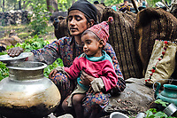 Jamila makes lunch, with some help from Yasin, while camped in the forests along the Asi Ganga River.
