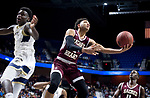 UNCASSVILLE, CT-031818JS16- Sacred Heart's Asian Gaiter (2) lays up a shot after getting past Notre Dame-Fairfield's Damion Medwinter (1) during their Division I championship game Sunday at Mohegan Sun Arena. <br /> Jim Shannon Republican-American