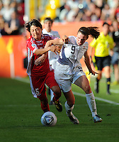 Heather O'Reilly (r) of Team USA and Song Jong Sun of North Korea during the FIFA Women's World Cup at the FIFA Stadium in Dresden, Germany on June 28th, 2011.