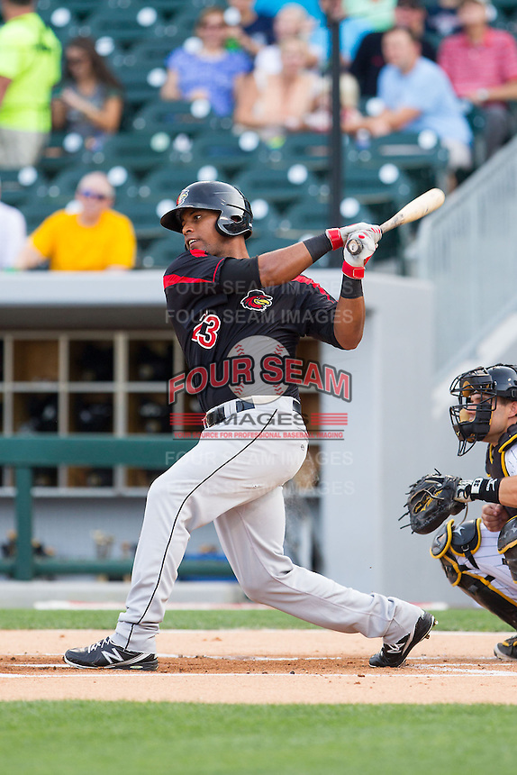 Deibinson Romero (23) of the Rochester Red Wings follows through on his swing against the Charlotte Knights at BB&T Ballpark on June 5, 2014 in Charlotte, North Carolina.  The Knights defeated the Red Wings 7-6.  (Brian Westerholt/Four Seam Images)