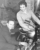 1950: John and Dorothy Surtees in their family motorcycle shop 1950s