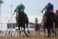 DEL MAR, CA - NOVEMBER 04: Bar of Gold #5, ridden by Irad Ortiz Jr.,faces off with Ami's Mesa #14, ridden by Luis Contreras, on the home stretch of the Breeders' Cup Filly & Mare Sprint on Day 2 of the 2017 Breeders' Cup World Championships at Del Mar Thoroughbred Club on November 4, 2017 in Del Mar, California. (Photo by Alex Evers/Eclipse Sportswire/Breeders Cup)