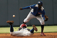 "Major League Baseball prospect Franklin Guzman is tagged out during the final game of the ""Torneo Supremo"" at the Quiskeya National Stadium in Santo Domingo. The Tournament which aims to maximize the ability of Major League Baseball organizations to scout in the Dominican Republic. According to the MLB's office in the Dominican Republic, this year, the tournament introduced 23 new baseball prospects. July 29 2011. ViewPress/ Kena Betancur"