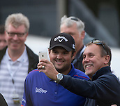 17.10.2014. The London Golf Club, Ash, England. The Volvo World Match Play Golf Championship.  Day 3 group stage matches. Patrick Reed [USA] poses for a selfie with a fan after his win over Jamie Donaldson (WAL).