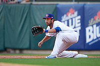 Buffalo Bisons first baseman Chris Colabello (41), on rehab assignment from the Toronto Blue Jays, stretches for a throw during a game against the Norfolk Tides on July 18, 2016 at Coca-Cola Field in Buffalo, New York.  Norfolk defeated Buffalo 11-8.  (Mike Janes/Four Seam Images)