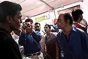 A Canon representative shares the features of a canon compact digital to interested customers at the Canon Image Express in Nagpur, Maharashtra, India.  Photograph: Sanjit Das/Panos