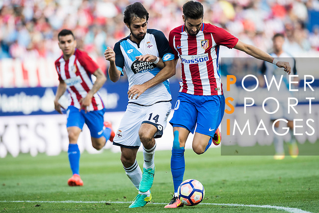 Yannick Ferreira-Carrascoof Atletico Madrid battles for the ball with Arribas of Deportivo de la Coruna during their La Liga match between Atletico Madrid and Deportivo de la Coruna at the Vicente Calderon Stadium on 25 September 2016 in Madrid, Spain. Photo by Diego Gonzalez Souto / Power Sport Images