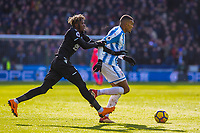 Huddersfield Town's forward Collin Quaner (23) goes by Crystal Palace's midfielder Wilfried Zaha (11) during the EPL - Premier League match between Huddersfield Town and Crystal Palace at the John Smith's Stadium, Huddersfield, England on 17 March 2018. Photo by Stephen Buckley / PRiME Media Images.