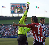 Referee Carlos Batres shows Chivas midfielder Francisco Mendoza (6) a yellow card during a SuperLiga game. Pachuca CF defeated the Chivas USA 2-1 during the 1st round of the 2008 SuperLiga at Home Depot Center stadium, in Carson, California on Sunday, July 13, 2008.