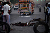 Port-au-Prince, Haiti.November 25, 1987..The street killing of a suspected ton-ton-macoute prior to elections being held on November 29th, the first attempt at a democratic election in Haiti. It was unsuccessful as 34 people were killed at a polling station and elections were moved up to February 1988...Leslie François Manigat won the election with many political parties boycotting. He had military backing but once in office he sought greater control over the military in an effort, to fight corruption. Manigat's government was overthrown by General Henri Namphy within months.