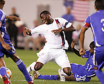 11 March 2008: Maurice Edu (USA) (6) is brought down by Enrique Villaurrutia (CUB) (11). The United States U-23 Men's National Team tied the Cuba U-23 Men's National Team 1-1 at Raymond James Stadium in Tampa, FL in a Group A game during the 2008 CONCACAF's Men's Olympic Qualifying Tournament.