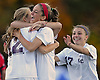 Garden City No. 14 Isabel Klatt (red head band) and No. 17 Jackie Morris congratulate No. 12 Chloe Stapleford after she scored a goal in the second minute of a Nassau County varsity girls' soccer Class A semifinal against Island Trees at Cold Spring Harbor High School on Friday, October 30, 2015. Klatt scored Garden City's second goal early in the second half in their 2-0 win.<br /> <br /> James Escher