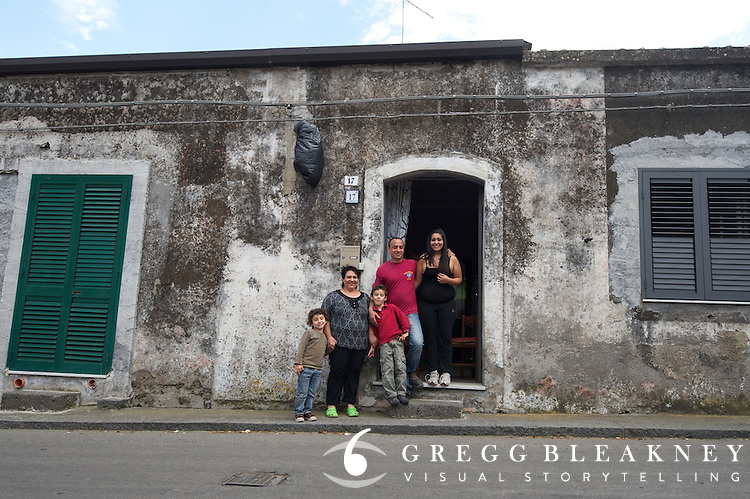 Zomegnan (race director) likes to bring the Giro to the people. In Sicily, the it ran right in front of this familiy's front door.