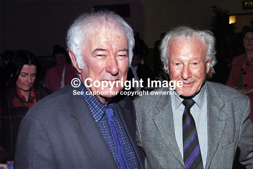 Nobel Laureate poet Seamus Heaney, left, meets Irish rugby legend Jack Kyle, a member of the winning Irish team in 1948 Five Nations Championship. The occasion was a lunch at Queen's University Belfast, followed by Heaney being interviewed by local Belfast broadcaster William Crawley. The Heaney interview was one in a series with politicians, academics, authors, historians, etc.  200912023174.<br />