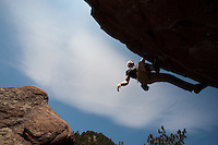 "Finance and corporate management guru Jim Collins, author of ""Good to Great: Why Some Companies Make the Leap... and Others Don't"" and other corporate self-help books, climbs boulders above Boulder, Colo., Monday, May 11, 2009. Collins' new book, ""How the Mighty Fall,"" is expected on publisher shelves soon. (Kevin Moloney for the New York Times)"