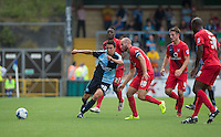 Luke O'Nien of Wycombe Wanderers passes under pressure from a group of York City players during the Sky Bet League 2 match between Wycombe Wanderers and York City at Adams Park, High Wycombe, England on 8 August 2015. Photo by Andy Rowland.