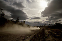 """Dust trails follow a car speeding toward Ushuaia on Argentina's Ruta 3. Despite a sour national economy and the difficulty of balancing economic development with environmental concerns, local residents and officials are working to bring the First World to the """"End of the World."""""""