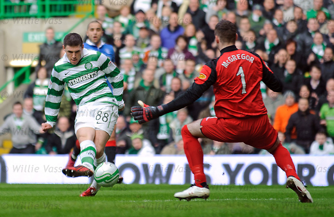 Gary Hooper slides the ball under Allan McGregor to open the scoring for Celtic