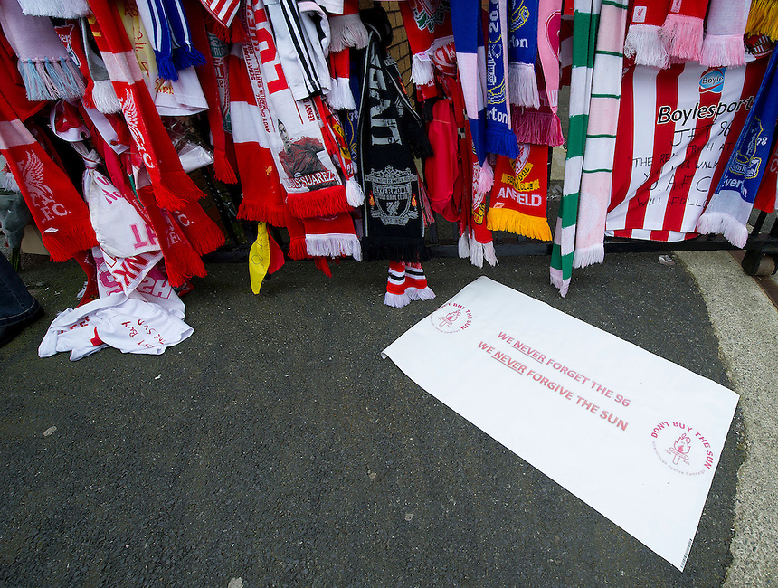 Tributes left in remembrance to those who lost their lives at the 1989 Hillsborough disaster at the memorial outside the gates to Anfield, home of Liverpool FC and a note condeming the Sun newspaper for printing a story proved to be untrie about the behaviour of Liverpool fans on the day in question..Football - Barclays Premiership - Liverpool v Manchester United - Sunday 23rd September 2012 - Anfield - Liverpool..