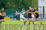Martin Mahony Ballylongford and James Jones Dr Crokes compete for the kickout during their Div 5 clash in Killarney on Sunday