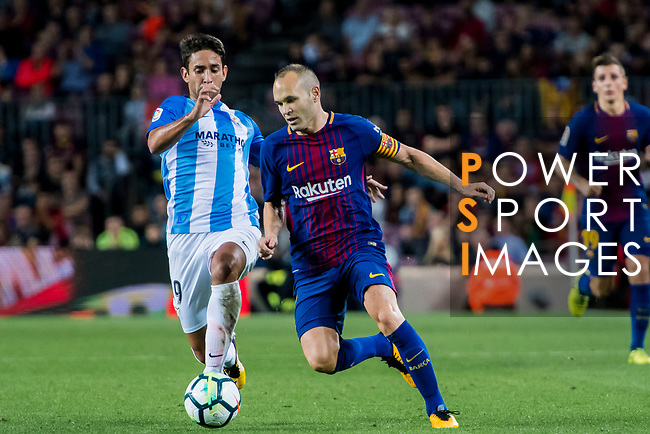 Andres Iniesta Lujan (r) of FC Barcelona is tackled by Rodrigo Emanuel Cecchini of Malaga CF during the La Liga 2017-18 match between FC Barcelona and Malaga CF at Camp Nou on 21 October 2017 in Barcelona, Spain. Photo by Vicens Gimenez / Power Sport Images