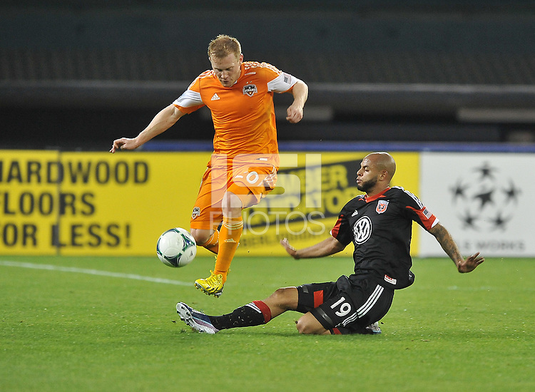 Andrew Driver (20) of the Houston Dynamo goes against Kyle Porter (19) of D.C. United. The Houston Dynamo defeated D.C. United 4-0, at RFK Stadium, Wednesday May 8 , 2013.