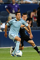Davy Arnaud (blue) Sporting KC midfielder holds off the challenge of Sam Cronin San Jose Earthquakes midfielder... Sporting KC defeated San Jose Earthquakes 1-0 at LIVESTRONG Sporting Park, Kansas City, Kansas.