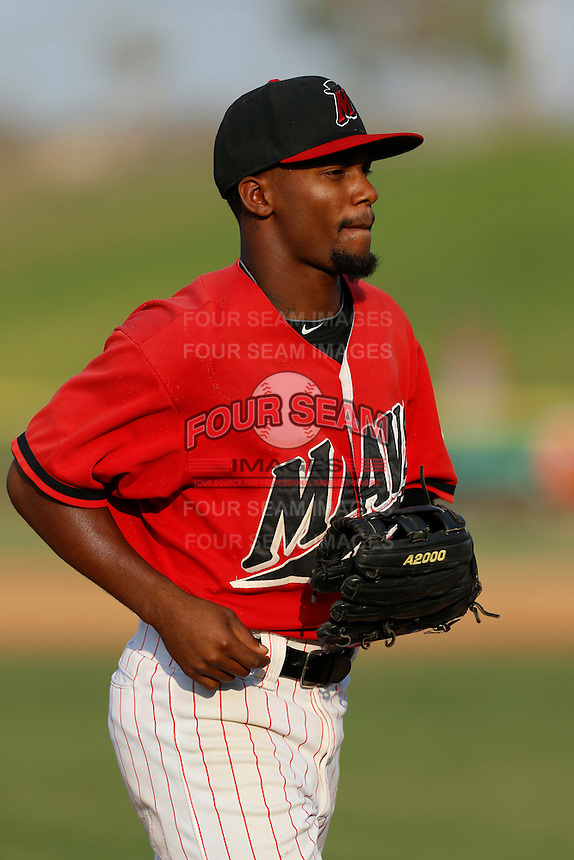 Jamal Austin #3 of the High Desert Mavericks returns from the outfield to the dugout during a game against the Modesto Nuts at Stater Bros. Stadium on June 29, 2013 in Adelanto, California. Modesto defeated High Desert, 7-2. (Larry Goren/Four Seam Images)