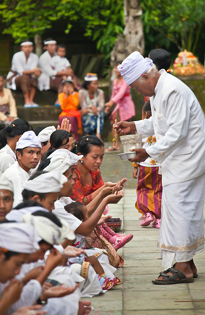 A Hindu crowd worships at the PURA TIRTA EMPUL TEMPLE COMPLEX during the GALUNGAN FESTIVAL -  TAMPAKSIRING, BALI, INDONESIA