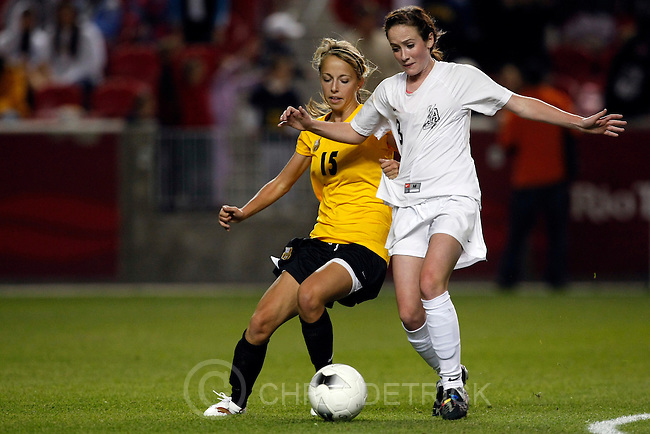Photo by Chris Detrick  |  The Salt Lake Tribune .Davis' Mckinsee Hall #15 and Alta's Michele Murphy #8 go for the ball during the second half of the 5A girls' soccer finals at Rio Tinto Stadium Friday October 23, 2009. Alta won the game 4-3.Alta won its 4th straight 5-A state championship.