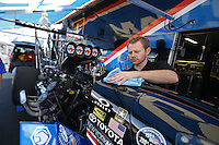 Apr. 5, 2013; Las Vegas, NV, USA: (Editors note: Special effects lens used in creation of this image) Crew member works on the car of NHRA top fuel dragster driver Antron Brown in the pits during qualifying for the Summitracing.com Nationals at the Strip at Las Vegas Motor Speedway. Mandatory Credit: Mark J. Rebilas-