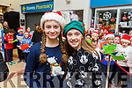 Ailbhe Fleming and Amber Foley from Currow at the Garveys Christmas Food Fair in Castleisland on Tuesday night.