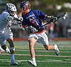 Peter Lapina #6 of Manhasset, right, gets pressured by Cole Dutton #11 of Garden City during the 133rd Woodstick Classic at Garden City High School on Saturday, April 28, 2018. Lapina scored a goal to break a 4-4 tie midway through the fourth quarter to lead Manhasset to a 7-4 win.