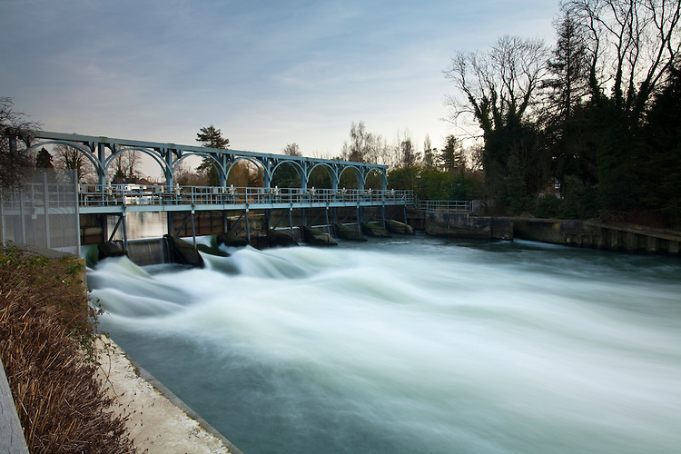 The River Thames cascading over the sluice gates at Marsh Lock and Weir near Henley, Oxfordshire, Uk