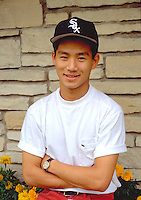 17 year old male Vietnam American smiling by his family house.  St Paul Minnesota USA