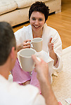 Mature woman chatting with her mate and drinking coffee