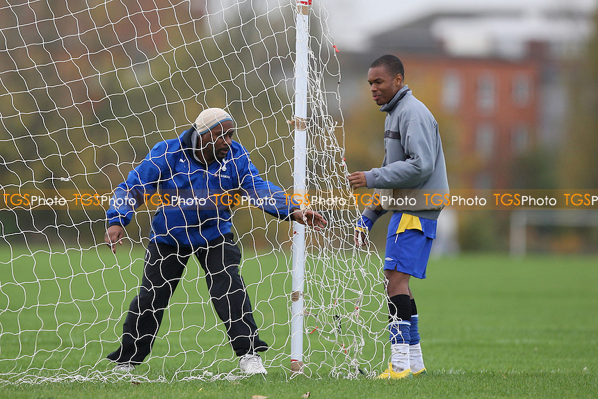 Stoke Newington FC players are seen putting up the goal nets prior to an East London Sunday League match at Hackney Marshes - 09/11/08 - MANDATORY CREDIT: Gavin Ellis/TGSPHOTO - Self billing applies where appropriate - Tel: 0845 094 6026