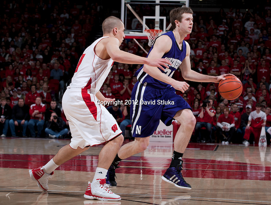 Wisconsin Badgers guard Ben Brust (1) defends against Northwestern Wildcats forward John Shurna (24) during a Big Ten Conference NCAA college basketball game on January 18, 2012 in Madison, Wisconsin. The Badgers won 77-57. (Photo by David Stluka)