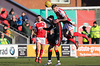 Ashley Eastham of Fleetwood Town (right) beats Robbie Muirhead of MK Dons in the air during the Sky Bet League 1 match between Fleetwood Town and MK Dons at Highbury Stadium, Fleetwood, England on 24 February 2018. Photo by David Horn / PRiME Media Images