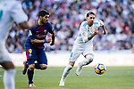 Sergio Ramos (R) of Real Madrid battles for the ball with Luis Alberto Suarez Diaz of FC Barcelona during the La Liga 2017-18 match between Real Madrid and FC Barcelona at Santiago Bernabeu Stadium on December 23 2017 in Madrid, Spain. Photo by Diego Gonzalez / Power Sport Images