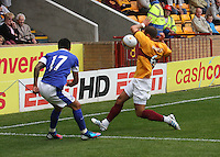 Tom Hateley blocks the cross of Tim Cahill in the Motherwell v Everton friendly match at Fir Park, Motherwell on 21.7.12 for Steven Hammell's Testimonial.