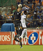 Carlos Bocanegra heads the ball. .USA clinches a spot in the  2010 World Cup after defeating Honduras in 3-1 during CONCACAF qualifying in San Pedro Sula, Honduras, October 10, 2009.