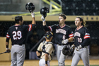 Eric Jones (6) of the Davidson Wildcats taps helmets with teammate Jake Sidwell (29) after hitting his second home run of the game against the Wake Forest Demon Deacons at David F. Couch Ballpark on February 28, 2017 in Winston-Salem, North Carolina.  The Demon Deacons defeated the Wildcats 13-5.  (Brian Westerholt/Four Seam Images)