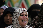 Palestinian mourners cry during the funeral of Palestinian Bashir Abdel Aal, 20,in Rafah in the southern Gaza Strip, following an Israeli air strike before a five-hour truce went into effect on July 17, 2014 Israeli shelling killed four Palestinian boys on a Gaza beach on Wednesday, an incident the military called tragic, and Israel and Hamas said they would cease attacks for five hours on Thursday for a humanitarian truce requested by the United Nations. Palestinian militants fired more than 130 rockets into Israel on the ninth day of a war in which Israeli attacks have killed 231 Palestinians, including six in two air strikes on Wednesday. Most of the casualties were civilians, health officials in Gaza said. In Israel, a civilian has been killed by one of more than 1,000 Palestinian rockets fired and more than half a dozen people have been wounded. Photo by Eyad Al Baba